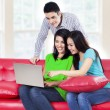 Group of young people on a laptop — Stock Photo #31230517