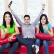 Happy young teenager watching tv at home — Stock Photo
