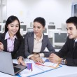 Three asian business team with laptop at office — Stock Photo #31230851
