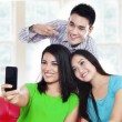 Three teenagers take a picture at home — Stock Photo