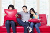 Three young teenagers watching TV — Stock Photo