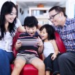 Family using digital tablet browsing the internet — Stock Photo #31266833