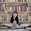 Excited female student at library — Stock Photo