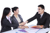 Business people shaking hands at meeting — Stock fotografie
