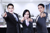 Asian business team pointing — Stock Photo