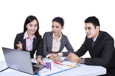 Business team working with laptop - isolated — Stock Photo