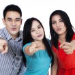 Group of young people standing point finger at you — 图库照片