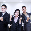 Business people celebrating triumph with arms up — Stok Fotoğraf #31583597