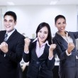 Stock Photo: Business people celebrating triumph with arms up