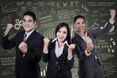 Business team celebrating a triumph — Stock Photo