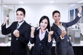 Business people celebrating a triumph with arms up — Stock Photo