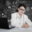 Beautiful doctor write prescription at lab — Stock Photo
