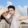 Asian couple take picture at Sydney Opera House — Stock Photo