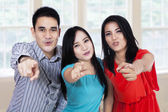 Group of friends pointing at you — Foto Stock