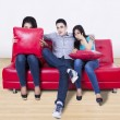 Three young friends watching TV — Stock Photo