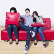 Three young friends watching TV — Stockfoto