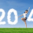Beautiful dancer woman with 2014 New Year clouds — Stock Photo #32080297