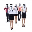 Business team hiding behind question mark symbol — Stock Photo