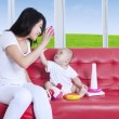 Mother and baby having fun — Stock Photo