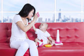 Happy mother and baby playing toys at home — Stock Photo