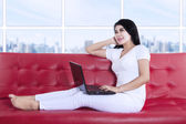 Asian woman with laptop — Stock Photo