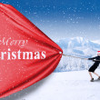 Business team pull christmas banner — Stock Photo
