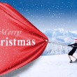 Business-Team ziehen Christmas banner — Stockfoto