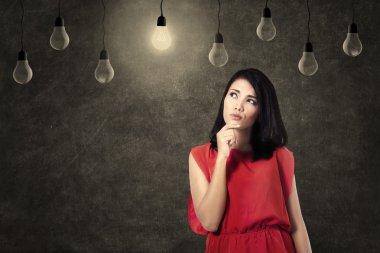Creative woman thinking of ideas
