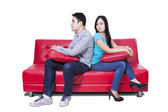Angry couple sitting back to back — Stock Photo