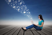 Female student typing on laptop outdoor — Stock Photo