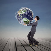 Businesswoman holding the world — Stock Photo