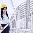 Beautiful architect with blueprint — Stock Photo