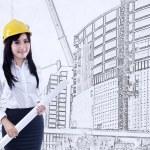 Beautiful architect with blueprint — Stock Photo #33680869