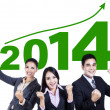 Business team celebrating a new year 2014 — Stock Photo #33681257