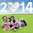 Cheerful family enjoying new year holiday — Stock Photo