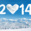New year 2014 with heart shaped cloud — Stock Photo