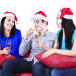 Three young people drink champagne — Stock Photo