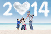 Asian family celebrate new year at beach — Stock Photo