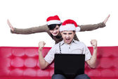 Successful young christmas couple — Stock Photo