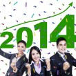 Excited business people celebrating a new year 2014 — Stock Photo