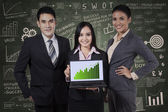 Business people holding growth graph — Stock Photo