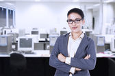 Businesswoman smiling in an office — Stock Photo