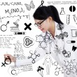 Female doctor drawing on transparent screen — Stock Photo