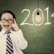 Male student with number of new year 2014 — Foto de Stock