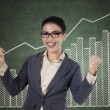 Happy winning businesswoman with arms up — Stock Photo #34776297