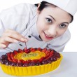 Woman chef decorates a cake — Stock Photo