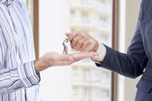 Handing of keys from one man to other — Stock Photo