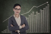 Confident businesswoman with growth graph — Stock Photo