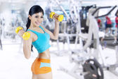 Fitness woman working out with dumbbells — ストック写真