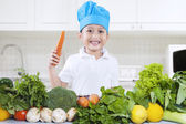 Chef boy is cooking vegetables — Stock Photo